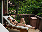 Young Woman Reclining in Deck Chair