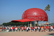 ANAHEIM, CA - AUGUST 24:  Fans cue up near a large sculpture of a baseball cap outside the main entrance to the stadium for the Los Angeles Angels of Anaheim game against the Minnesota Twins at Angel Stadium on August 24, 2008 in Anaheim, California. The Angels defeated the Twins 5-3. ©Paul Anthony Spinelli