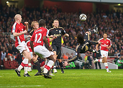 LONDON, ENGLAND - Wednesday, October 28, 2009: Arsenal's Philippe Senderos handles the ball after a shot from Liverpool's Alberto Aquilani during the League Cup 4th Round match at Emirates Stadium. (Photo by David Rawcliffe/Propaganda)