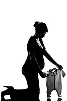 beautiful caucasian pregnant woman  baby clothes in full length silhouette on studio isolated white background