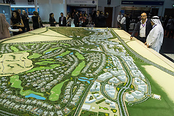 Model of new luxury housing estate at Dubai Hills Estate by developer Emaar at property trade fair in Dubai United Arab Emirates