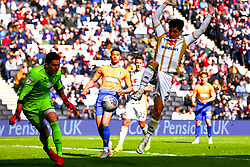George Williams of Milton Keynes Dons attempts to clear the ball - Mandatory by-line: Ryan Crockett/JMP - 04/05/2019 - FOOTBALL - Stadium MK - Milton Keynes, England - Milton Keynes Dons v Mansfield Town - Sky Bet League One
