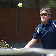 Jimmy Parker, USA,  in action in the 65 Mens Singles during the 2009 ITF Super-Seniors World Team and Individual Championships at Perth, Western Australia, between 2-15th November, 2009.