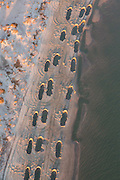 Aerial view of giant holes in the sand during a beach restoration project to halt erosion in Charleston, SC