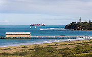 Queenscliff Pier and headland with container ship passing