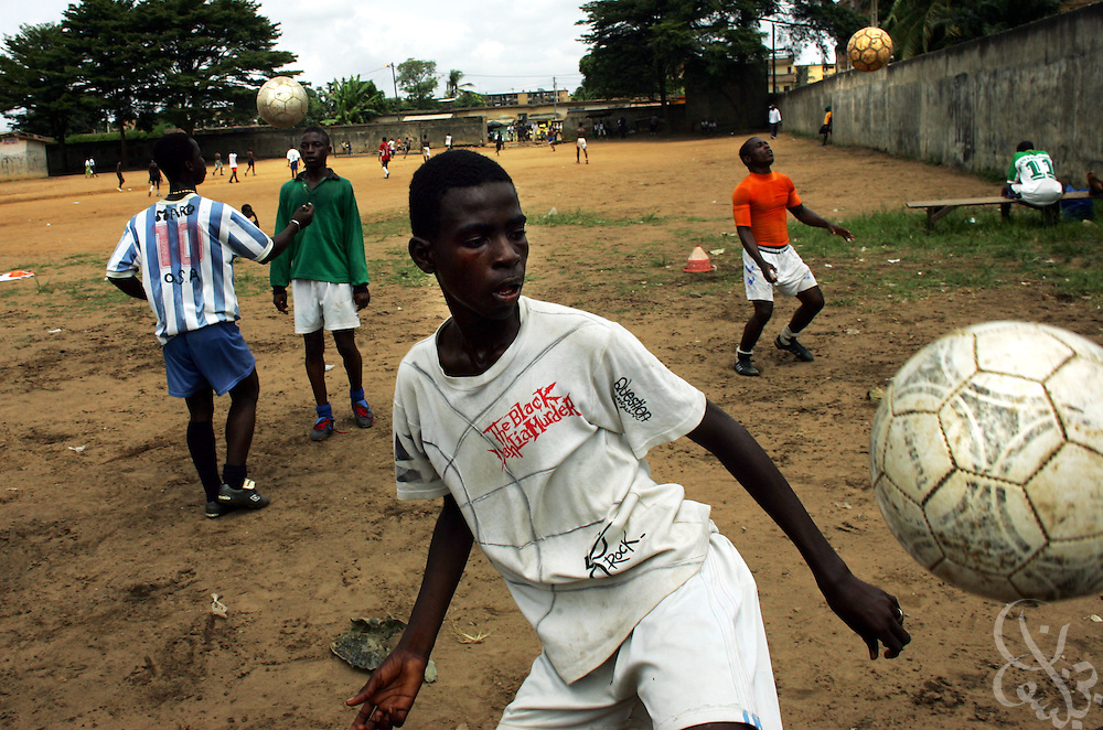 Ivorian youths practice at the Olympic Sport Abobo club in the Abobo neighborhood of Abidjan, Ivory Coast February 18, 2006. Spawned from the success of the ASEC academy, some 300 rival football academies have arisen in Abidjan, mostly in poorer neighborhoods, and looking to reproduce the same results on the cheap, with little or no emphasis placed on education.