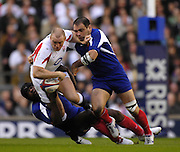 Twickenham, GREAT BRITAIN, Mike TINDALL, looses the ball in the tackle from Serge BETSEN low and Raohael IBANEZ, during the England vs France Six Nations Rugby International at Twickenham Stadium England on Sunday 11.03.2007,  [Photo Peter Spurrier/Intersport Images]