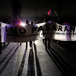"Protestors march along carrying a banner ""No Pasaran"" (They shall not pass) in protest of the inauguration of President-elect Donald Trump starting on Valinda and walking toward Hacienda in La Puente, Calif., on Friday, Jan. 20, 2017."