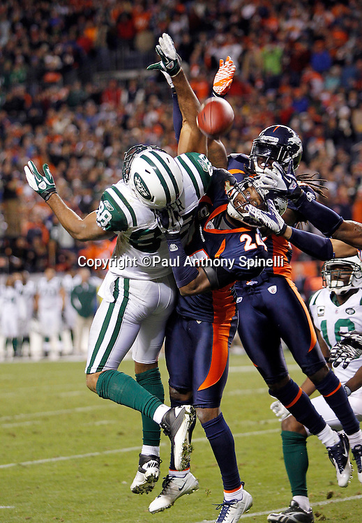 New York Jets wide receiver Patrick Turner (88) leaps for a Hail Mary pass broken up by Denver Broncos cornerback Champ Bailey (24) and a teammate as they go airborne on the last play of the NFL week 11 football game against the Denver Broncos on Thursday, November 17, 2011 in Denver, Colorado. The Broncos won the game 17-13. ©Paul Anthony Spinelli