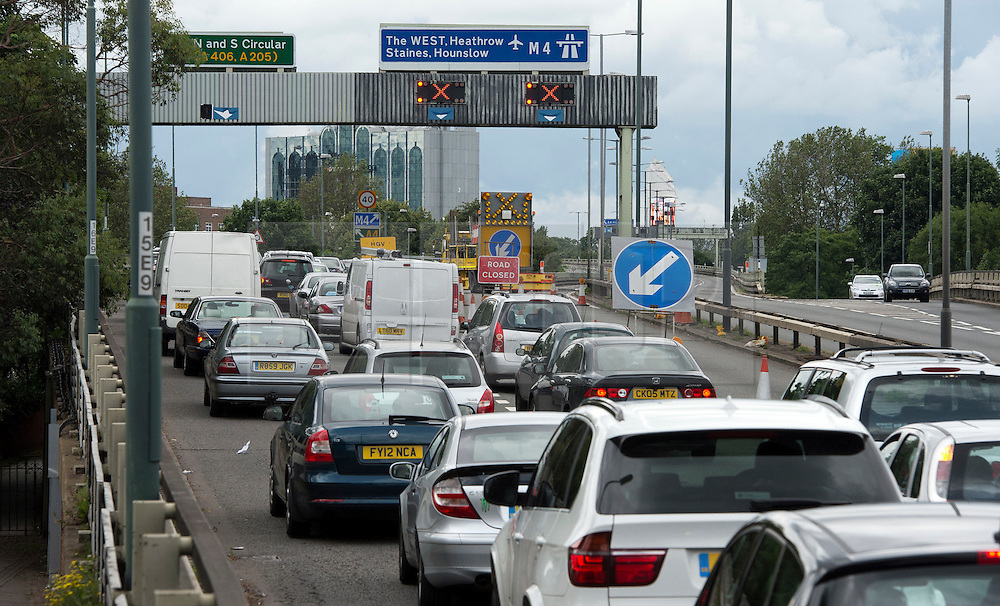 © London News Pictures. 07/07/2012. Traffic queueing to leave the M4 motorway Westbound at junction 1 in London on July 7, 2012. The M4 has been closed between junctions 1 and 3 until Thursday at the earliest after a crack was found in a 'sensitive area' of an elevated section of the motorway. The M4, part of the Olympic Route Network, will be vital for transporting visitors into the city from Heathrow Airport. Photo credit: Ben Cawthra/LNP.