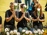 20 OCTOBER 2016 - BANGKOK, THAILAND:  People mourning the death of Bhumibol Adulyadej, the King of Thailand, leave flowers for His Majesty at Sanam Luang. Sanam Luang, the Royal Ceremonial Ground, is packed with people mourning the Monarch's death. The King died Oct. 13, 2016. He was 88. His death came after a period of failing health. Bhumibol Adulyadej was born in Cambridge, MA, on 5 December 1927. He was the ninth monarch of Thailand from the Chakri Dynasty and is also known as Rama IX. He became King on June 9, 1946 and served as King of Thailand for 70 years, 126 days. He was, at the time of his death, the world's longest-serving head of state and the longest-reigning monarch in Thai history.      PHOTO BY JACK KURTZ