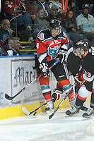 KELOWNA, CANADA, OCTOBER 26:  Madison Bowey #4 is checked into the boards as the Prince George Cougars visit the Kelowna Rockets  on October 26, 2011 at Prospera Place in Kelowna, British Columbia, Canada (Photo by Marissa Baecker/Shoot the Breeze) *** Local Caption *** Madison Bowey;