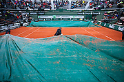 Employees cover the court number 1 with a tarpaulin as rain falls on Day Fifth during The French Open 2013 at Roland Garros Tennis Club in Paris, France.<br /> <br /> France, Paris, May 30, 2013<br /> <br /> Picture also available in RAW (NEF) or TIFF format on special request.<br /> <br /> For editorial use only. Any commercial or promotional use requires permission.<br /> <br /> Mandatory credit:<br /> Photo by &copy; Adam Nurkiewicz / Mediasport