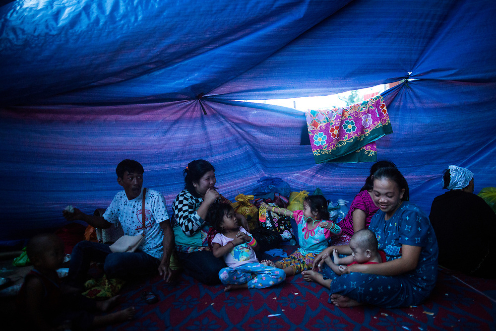 """MARAWI, PHILIPPINES - JUNE 10: Displaced residents try to live in a difficult conditions at an temporary evacuation center in Municipality of Saguiaran, Marawi, Southern Philippines, June 10, 2017. It's unclear how many people remain trapped in Marawi as government troops continue to battle Islamists rebels led by the so-called """"Maute"""" group but army officers have put the figure this week at anywhere from 150 to 1,000.  (Photo: Richard Atrero de Guzman/NUR Photo)"""