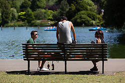 © Licensed to London News Pictures. 22/07/2014. London, UK. People enjoying the sunshine in St Regents Park in central London this lunchtime. Photo credit : Vickie Flores/LNP