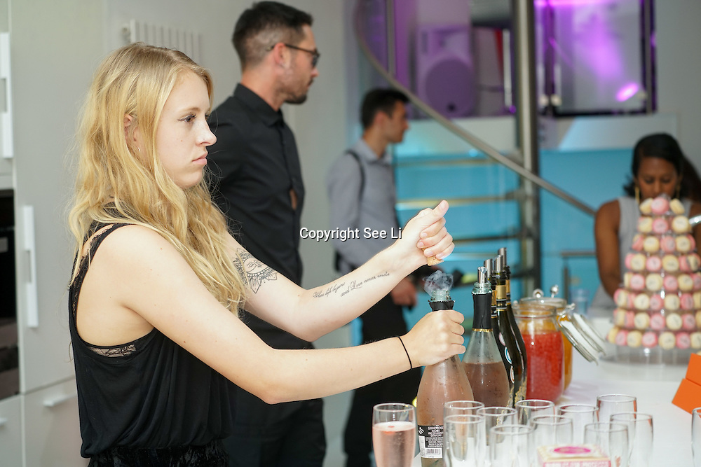London,England,UK, 11th Aug 2016 : A hosts of guests blogger, fashion designer and Olivia Buckland attend the wine retailer hosts summer party to sample its award-winning sparkling wine range at Icetank Studios, London,UK. Photo by See Li