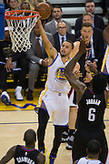 Golden State Warriors guard Stephen Curry (30) takes the ball to the basket against the LA Clippers at Oracle Arena in Oakland, Calif., on February 23, 2017. (Stan Olszewski/Special to S.F. Examiner)