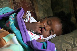 09 July 2006. New Orleans. Louisiana. <br /> Finding Faith. <br /> Faith Figueroa. A day in the life of. Faith takes a morning nap on the couch in front of the TV. Following a ten month search for the little girl whose face appeared on the Sept 19th, 2005 cover of Newsweek magazine, Faith's mother, Miriam Figueroa has returned to town with her three children. Faith, (1 yrs), Anfernya (5yrs) and Jacquelyn (13 yrs). <br /> Credit; Charlie Varley/varleypix.com