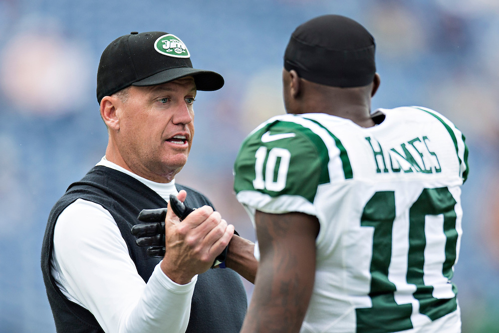NASHVILLE, TN - SEPTEMBER 29:  Head Coach Rex Ryan shakes hands with Santonio Holmes #10 of the New York Jets on the field before a game against the Tennessee Titans at LP Field on September 29, 2013 in Nashville, Tennessee.  The Titans defeated the Jets 38-13.  (Photo by Wesley Hitt/Getty Images) *** Local Caption *** Rex Ryan; Santonio Holmes