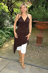 TV presenter PENNY SMITH at the annual House of Lords v House of Commons tug of war match in aid of  of  Macmillan Cancer Relief on 21st June 2005.  A drinks reception was held in College Gardens followd by the tug of war on Victoria Tower Gardens, London.                                 <br />