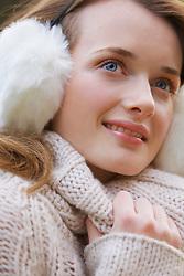Smiling Teenage Girl Wearing Earmuffs
