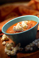 Popcorn makes a bowl of tomato vegetable soup a special treat.