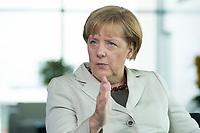 15 AUG 2013, BERLIN/GERMANY:<br /> Angela Merkel, CDU, Bundeskanzlerin, waehrend einem Interview, in ihrem Buero, Bundeskanzleramt<br /> IMAGE: 20130815-01-004<br /> KEYWORDS: Büro