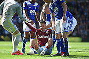 Aston Villa midfielder Jack Grealish (10) is helped to his feet after being assaulted by a pitch invader during the EFL Sky Bet Championship match between Birmingham City and Aston Villa at St Andrews, Birmingham, England on 10 March 2019.