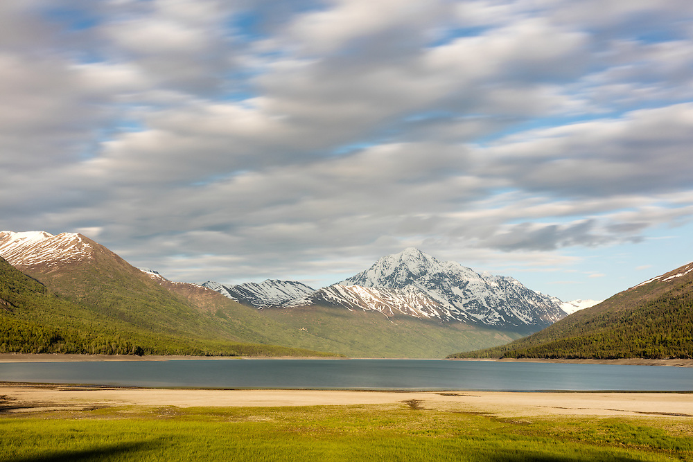 Long exposure of Eklutna Lake and Bold Peak in late evening in Chugach State Park in Southcentral Alaska. Spring.
