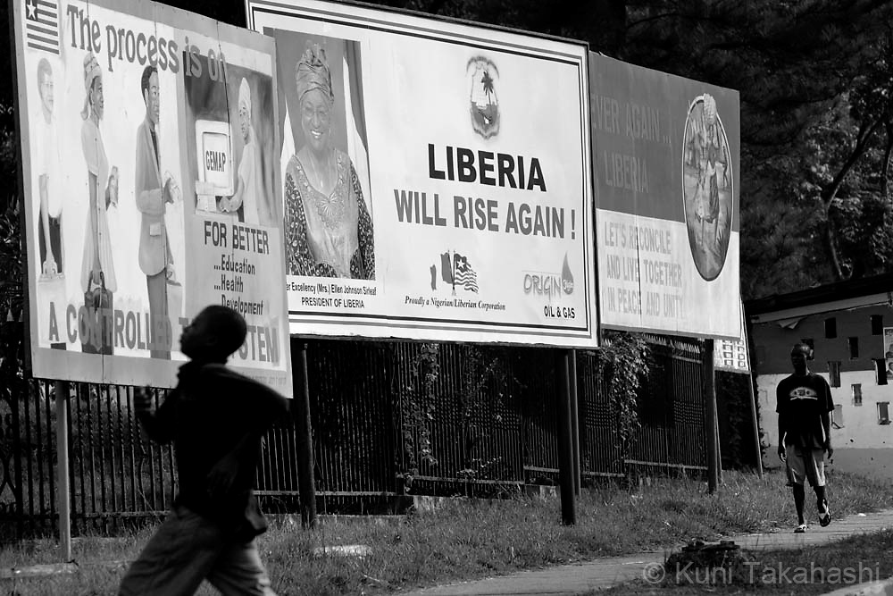 Billboards depicting President Ellen Johnson-Sirleaf are seen near the Capital building in Monrovia, Liberia, May 2, 2008. Despite the president's efforts to reduce corruption and build international support, Liberia has struggled to rebuild its economy since the end of its 14-year civil war in 2003.