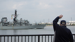 © Licensed to London News Pictures. 16/05/2016. HMS Kent is waved off by a resident of Greenhithe, Kent. The Type-23 frigate HMS Kent has left London after a short stay to head towards commemorative events to mark the centenary of the Battle of Jutland. She leaves London for Rosyth, a major port and key ship building area of the First World War, where she will take part in events organized by the Scottish Government at South Queensferry. She will then sail for Scapa Flow where she will provide a gun salute. Credit : Rob Powell/LNP