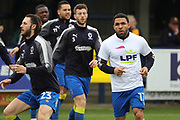 AFC Wimbledon defender Callum Kennedy (23) and AFC Wimbledon striker Andy Barcham (17) wamring up during the EFL Sky Bet League 1 match between AFC Wimbledon and Scunthorpe United at the Cherry Red Records Stadium, Kingston, England on 7 April 2018. Picture by Matthew Redman.
