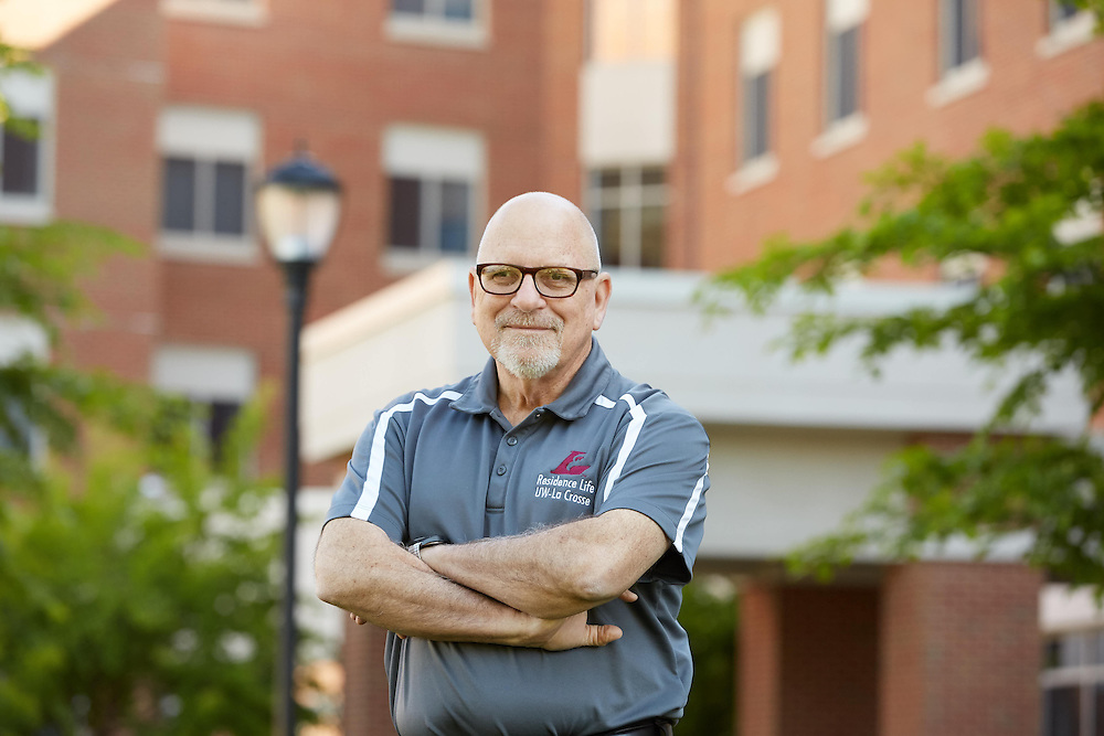 Buildings; Dorm; Residence Dorm; Eagle Hall; Location; Outside; People; Man Men; Spring; May; Time/Weather; day; Type of Photography; Portrait; UWL UW-L UW-La Crosse University of Wisconsin-La Crosse; Nick Nicklaus Office of Residence life director retired