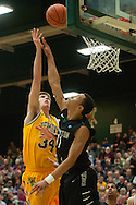 Catamounts forward Kurt Steidl (34) leaps over Binghamton's Romello Walker (11) for a basket during the men's basketball game between the Binghamton Bearcats and the Vermont Catamounts at Patrick Gym on Monday night January 19, 2015 in Burlington, Vermont. (BRIAN JENKINS, for the Free Press)