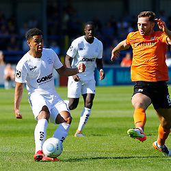 Barnets midfielder Charlee Adams stretches to intercept Dovers forward Jamie Allen during the National League match between Dover Athletic and Barnet FC at Crabble Stadium, Kent on 1 September 2018. Photo by Matt Bristow.