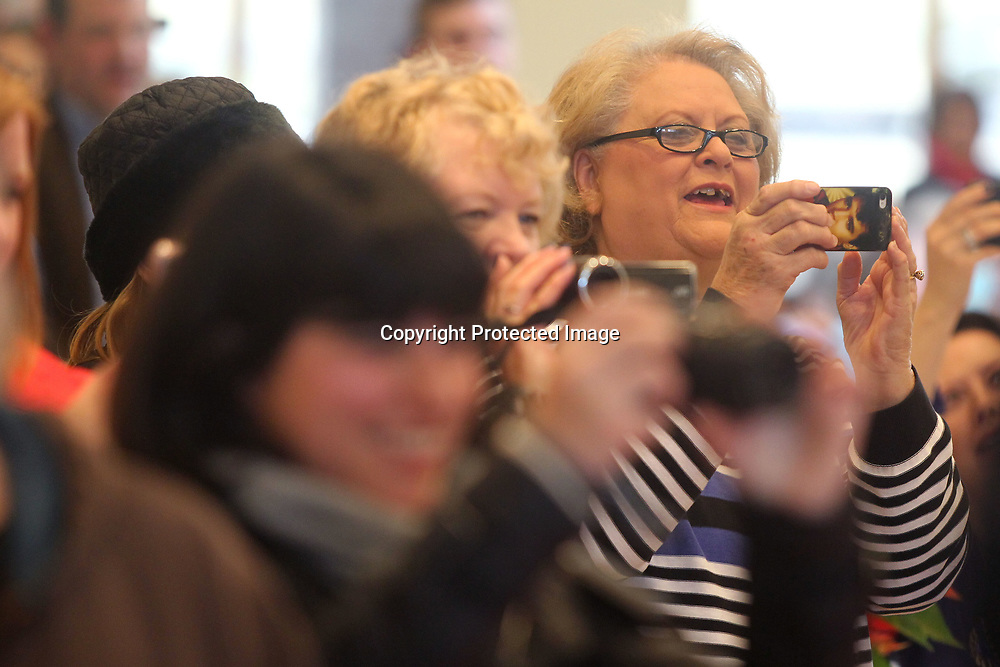 Marsha Whitehead, of Corinth, records videos with her phone as she sings Happy Birthday to Elvis during his Birthday celebration at the birthplace Monday afternoon in Tupelo.