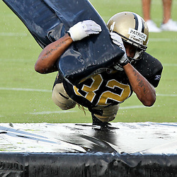 August 9, 2011; Metairie, LA, USA; New Orleans Saints cornerback Johnny Patrick (32) runs a tackling drill  in a rain storm during training camp practice at the New Orleans Saints practice facility. Mandatory Credit: Derick E. Hingle