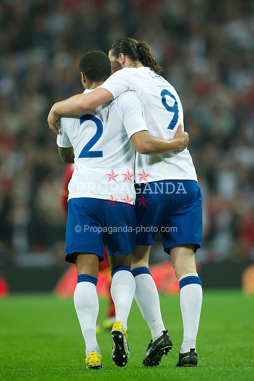 LONDON, ENGLAND - Tuesday, March 29, 2011: England's Andy Carroll celebrates scoring the first goal against Ghana with team-mate Glen Johnson during the international friendly match at Wembley Stadium. (Photo by David Rawcliffe/Propaganda)