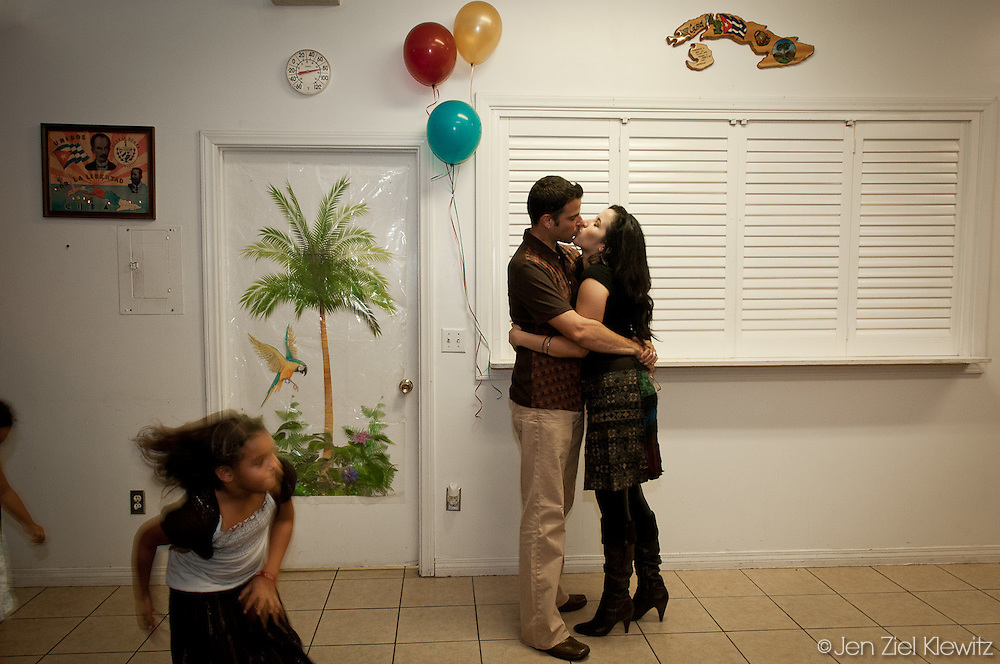 Lee Hetelson, of Oakland, Calif.,  steals a kiss from his fiance Nereida Rodriguez, of Los Angeles, Calif., at the 90th birthday party of  Rodriguez's grandmother, held on November 6, 2010, at the Sociedad Jose Marti in Hawthorne, California. Photo by Jen Klewitz