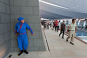 A man dressed as a ninja welcomes visitors to Haneda International Airport, Tokyo, Japan. Sunday August 31st 2014