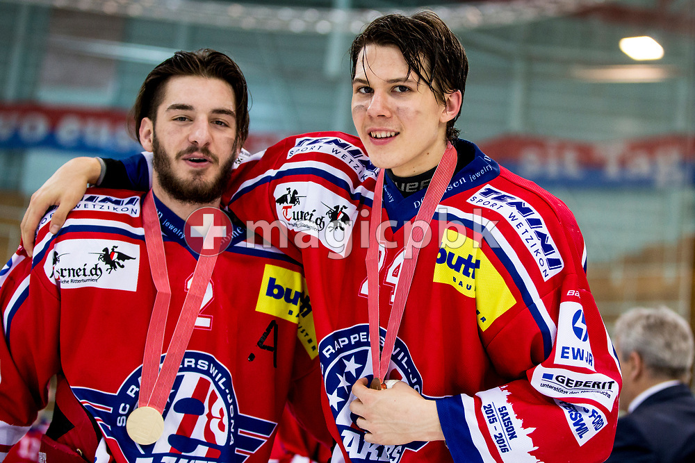 (L-R) Rapperswil-Jona Lakers defenseman Joel Brotzge and Lars Mathis pose for a photo with their gold medals after winning the fifth Elite B Playoff Final ice hockey game between Rapperswil-Jona Lakers and ZSC Lions held at the SGKB Arena in Rapperswil, Switzerland, Sunday, Mar. 19, 2017. (Photo by Patrick B. Kraemer / MAGICPBK)