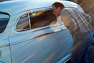 Mike Laliberte peers into a 1947 Mercury owned by Vernell Nichols during West Fargo Cruise Night on Sheyenne Street Thursday, June 19, 2014. Laliberte said he tries to make it to at least one cruise night during the summer. &quot;It's an eclectic mix of people of all ages and backgrounds out here. It's refreshing,&quot; he said.<br />  Nick Wagner / The Forum