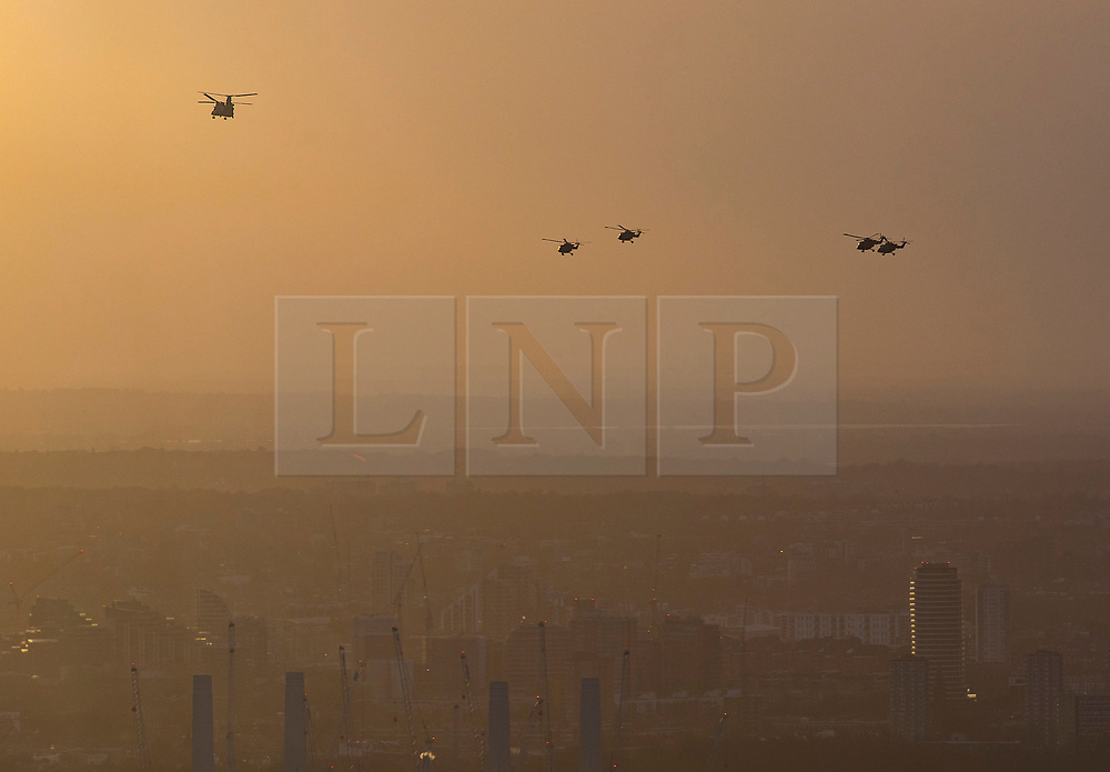 © Licensed to London News Pictures. 16/01/2018. London, UK.  The last four remaining British Army Lynx helicopters are escorted by a Chinook as they fly in formation over central London. The British made aircraft is being decommissioned after almost 40 years in service. Photo credit: Peter Macdiarmid/LNP