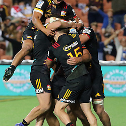 James Lowe mobbed from his team during the Investec Super  Rugby match between the Chiefs and Blues at FMG Waikato Stadium in Hamilton, New Zealand on Friday 3 March 2017. Photo: Dion Mellow / lintottphoto.co.nz