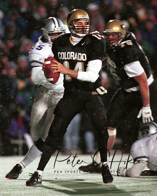 Colorado quarterback Koy Detmer (14) drops back to pass against Kansas State at Folsom Field in Boulder, Colorado in 1995.