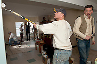 Gilford Rotarians paint the family wing at the Carey House in Laconia March 26, 2011.