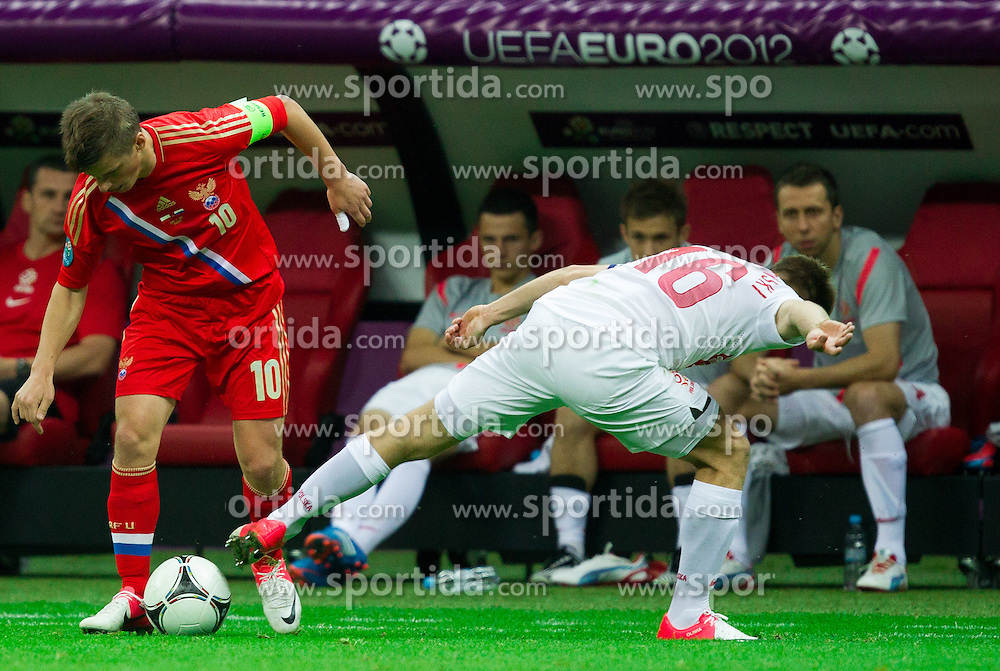 Andrey Arshavin of Russia vs Jakub Blaszczykowski of Poland during the UEFA EURO 2012 group A match between Poland and Russia at The National Stadium on June 12, 2012 in Warsaw, Poland.  (Photo by Vid Ponikvar / Sportida.com)