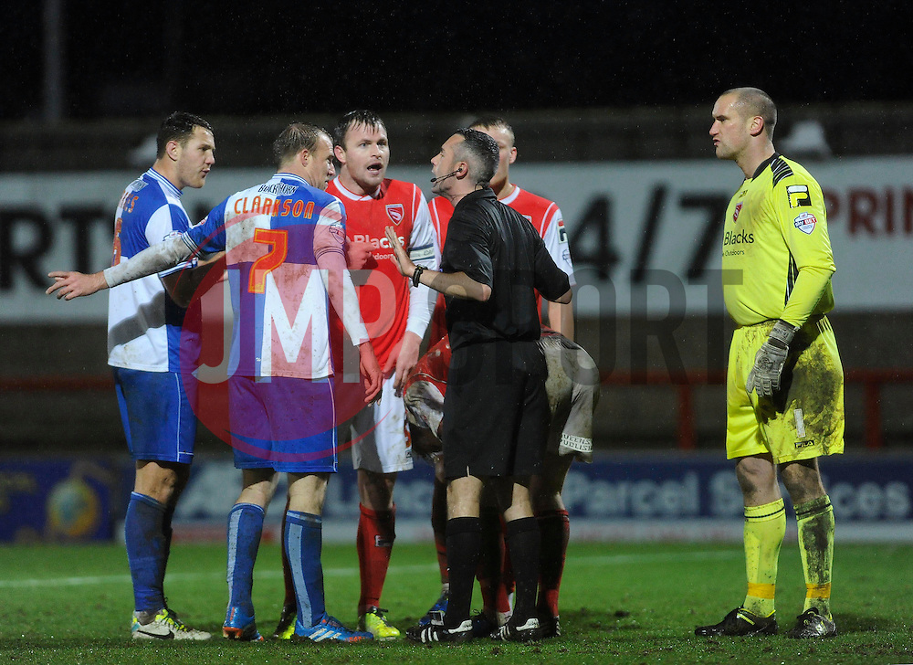 the players argue with the referee - Photo mandatory by-line: Dougie Allward/JMP - Tel: Mobile: 07966 386802 14/12/2013 - SPORT - Football - Morecombe - Globe Arena - Morecombe v Bristol Rovers - Sky Bet League Two