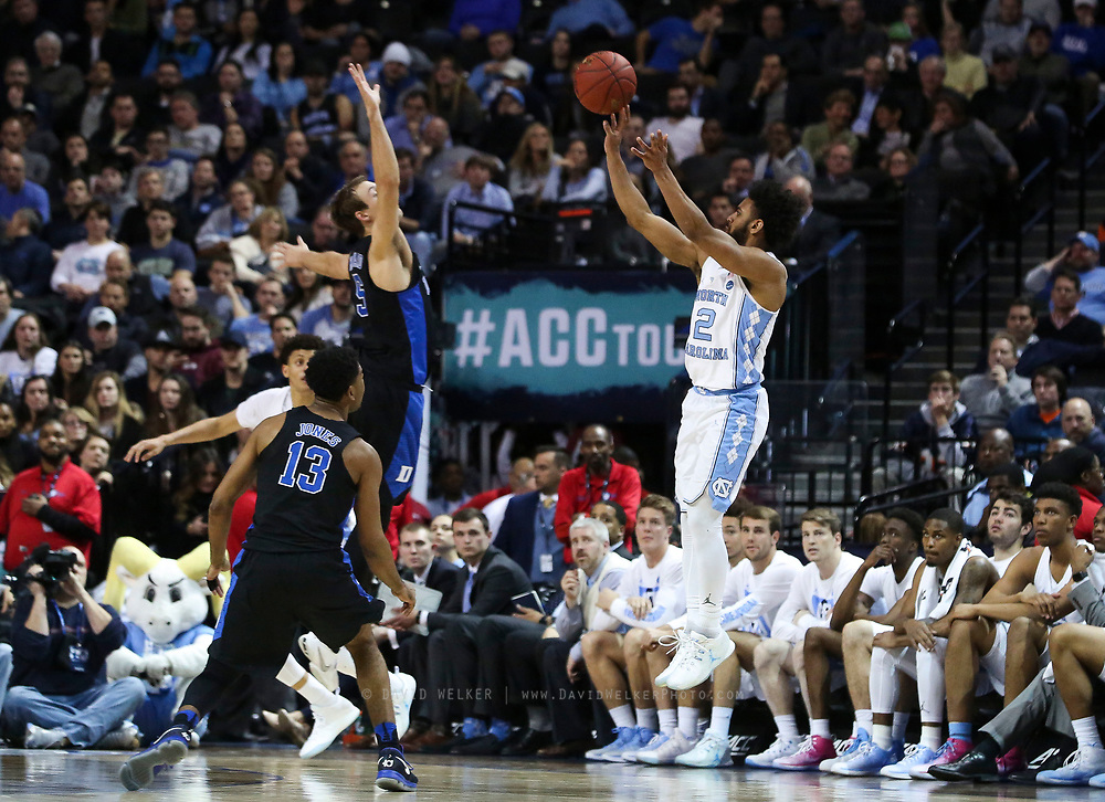 Duke forward Chase Jeter (2) shoots the ball over North Carolina forward Tony Bradley (5) during the semifinals of the 2017 New York Life ACC Tournament at the Barclays Center in Brooklyn, N.Y., Friday, March 10, 2017. (Photo by David Welker, theACC.com)