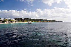 Roatan, Honduras:  Beautiful beaches are hallmark of West Bay, one of the most popular vacation spots on the island of Roatan. This barrier island off the north coast of Honduras sports many resorts.  The dark areas shown in the water are portions of the world's second largest barrier reef, making snorkeling from shore an easy swim.